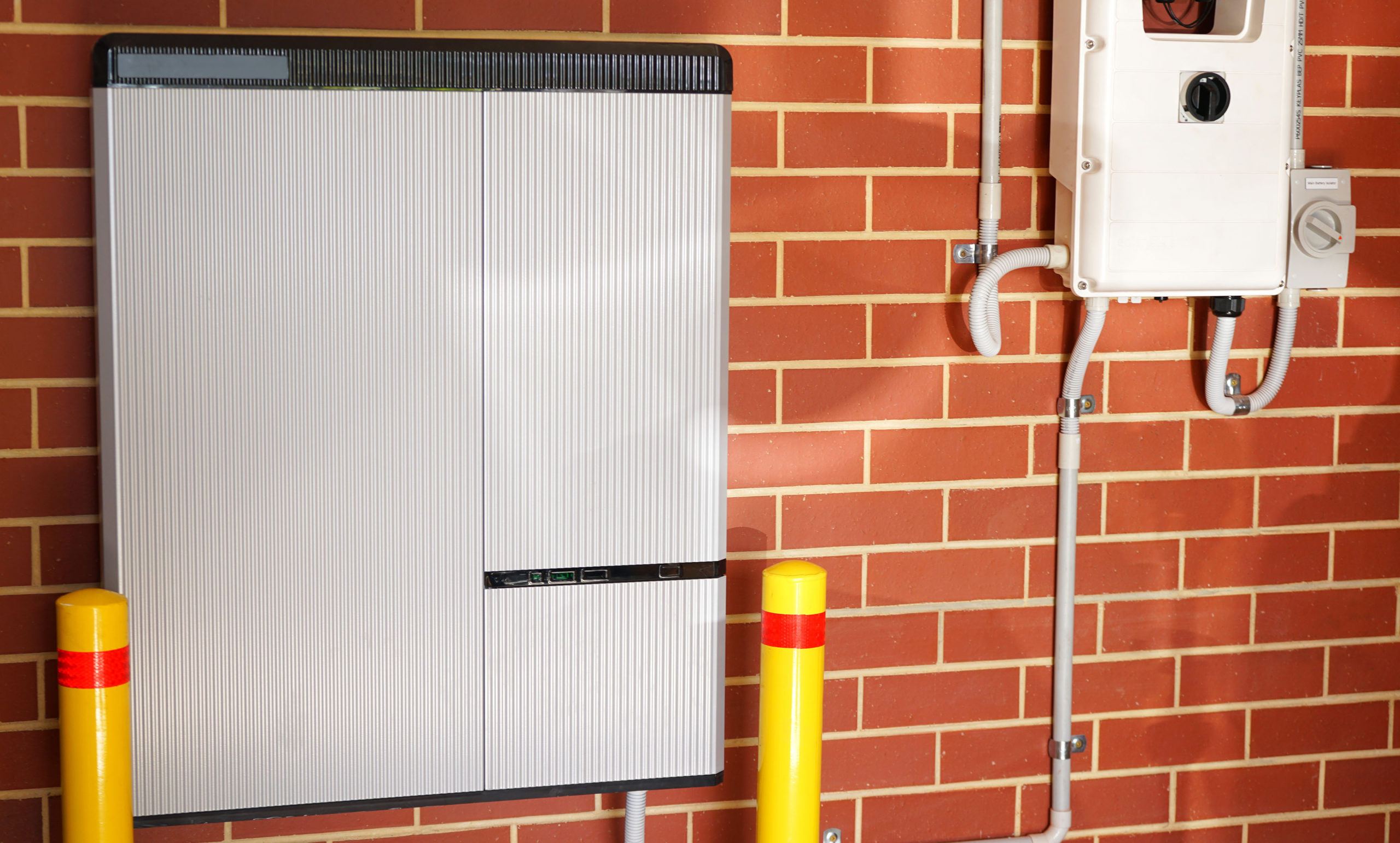 Lithium ion home battery and solar inverter solar panel system for domestic power storage installed in home garage.